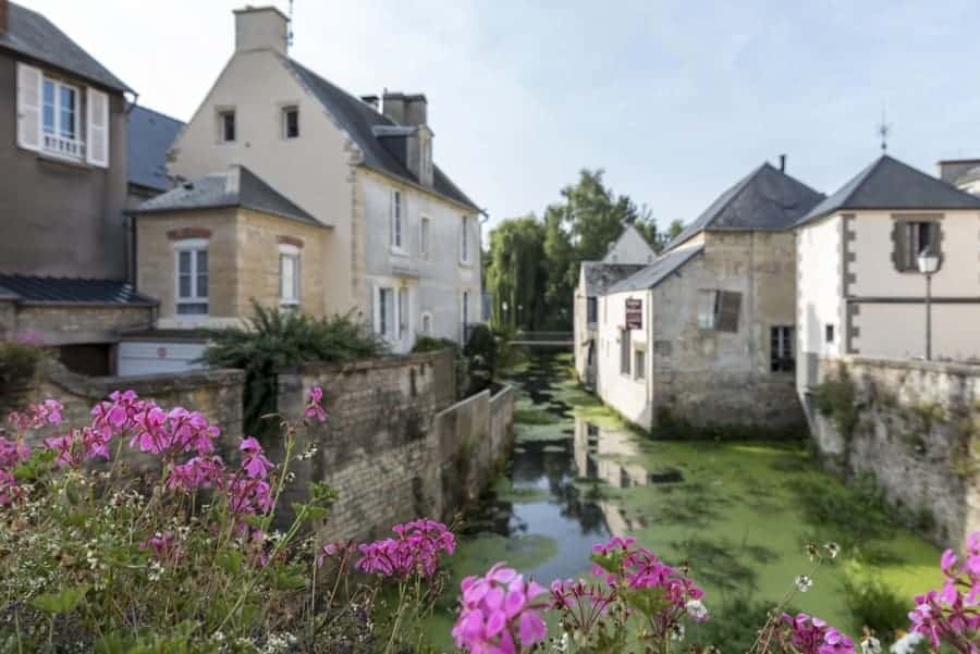 The River Aure flower through picturesque Bayeux Normandy which escaped unscathed from World War 2