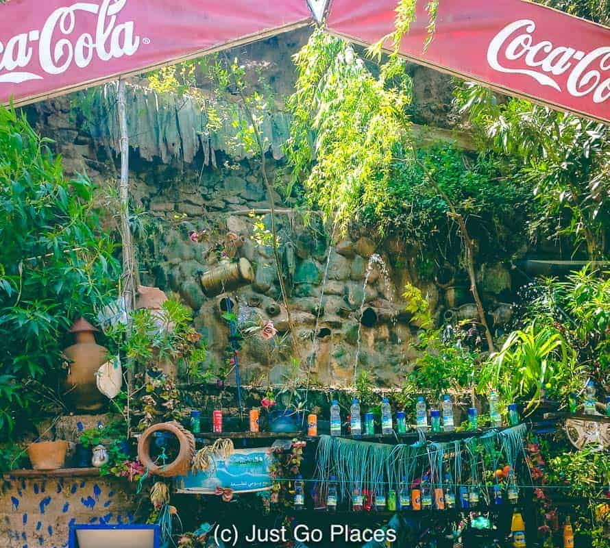 The cooling waters chill this Coca Cola stand set in an Ourika Valley waterfall.