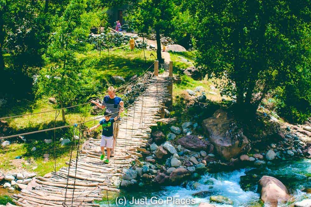 Clambering around a rope bridge in the Ourika Valley Morocco