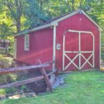 A sweet little red barn set over a creek inhellip