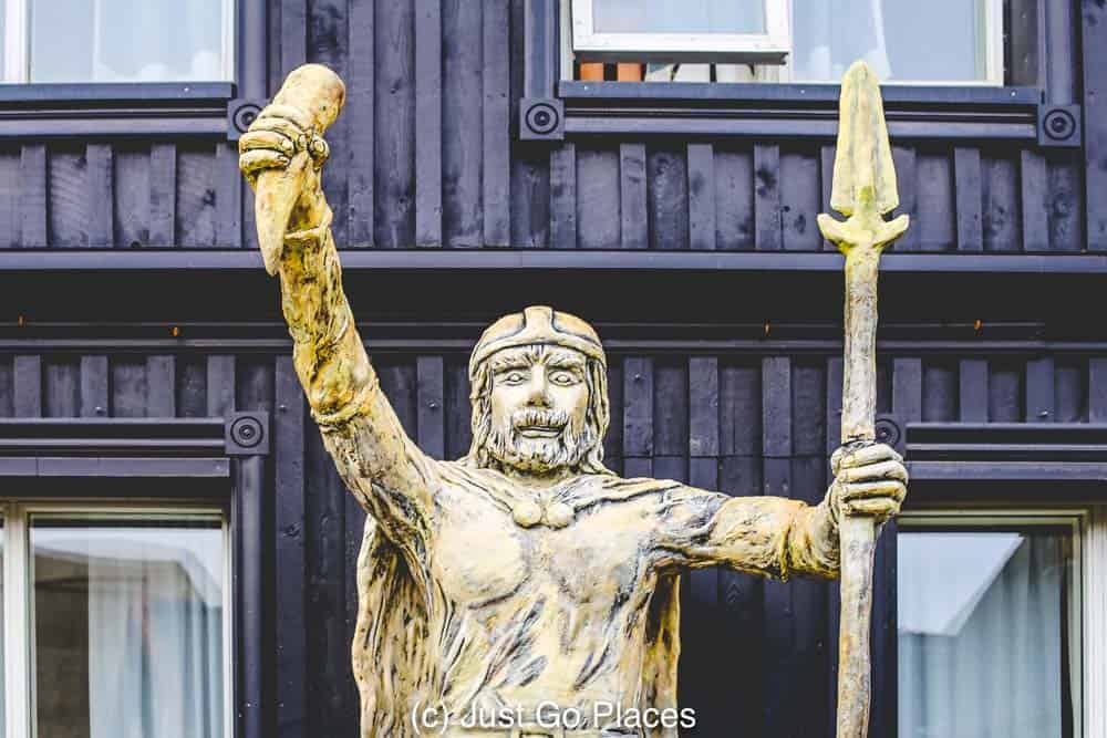 A wooden Viking statue at Viking Village in Hafnarfjordur Iceland