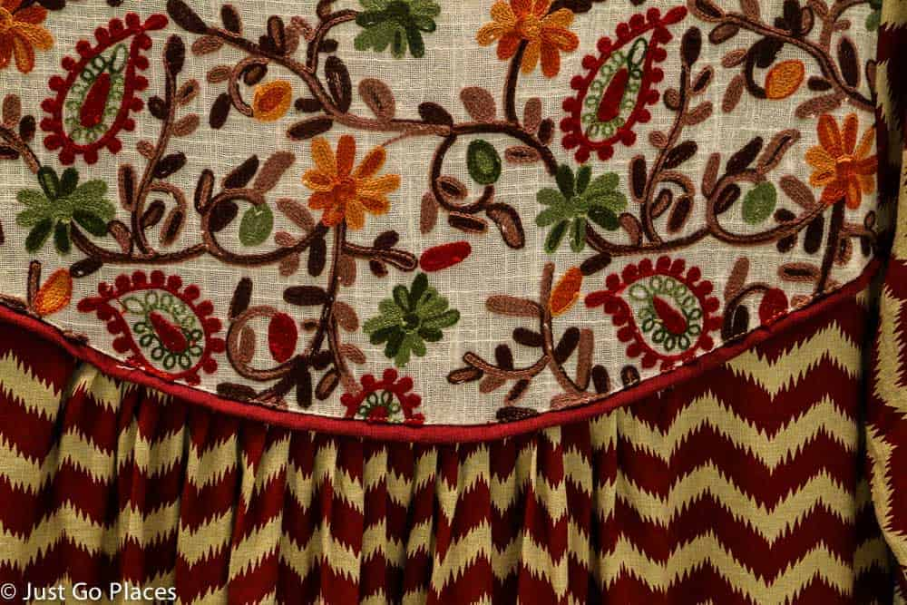 Traditional embroidery instead of glitter and beading.