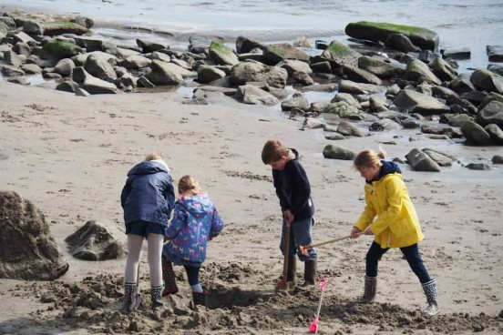 kids enjoying themselves at the beach in England
