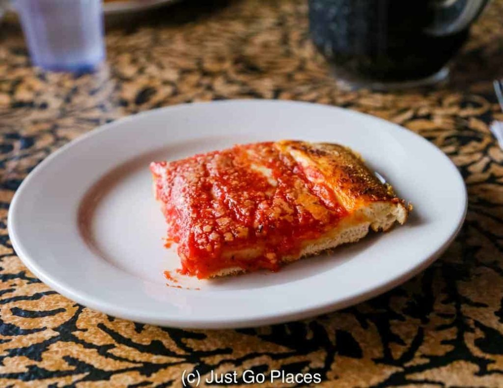 A slice of Sicilian pizza from L&B Spumoni Gardens in Brooklyn