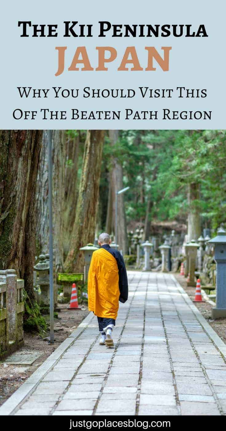 A monk walks on a path in Koyasan