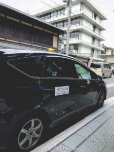 A taxi marks that it is foreign friendly in Kyoto