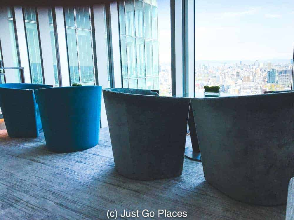 Tub chairs in the lounge which overlook the Osaka city skyline