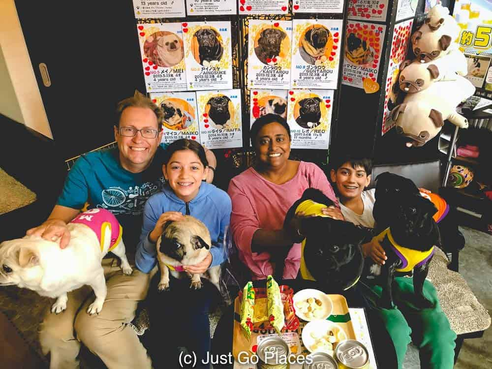 couch with family at the Living Room Pug Cafe in Kyoto