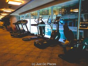 The small hotel gym overlooks the mall.