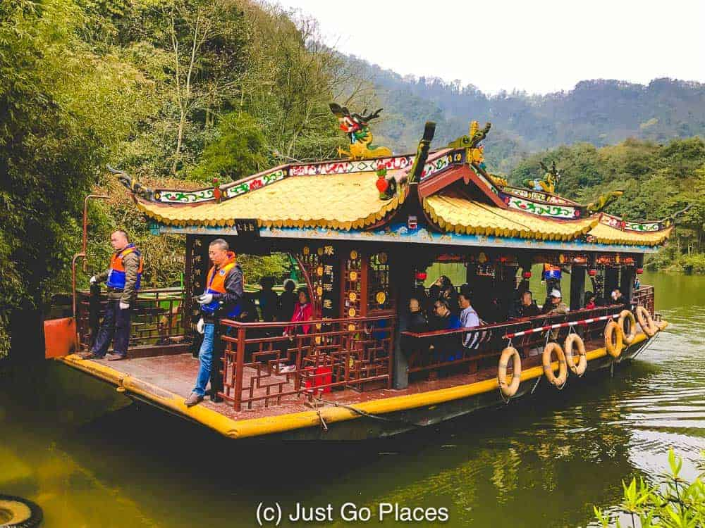 A boat crossing a lake in Mt Qingcheng - Taoism sacred places which has temples dotted throughout