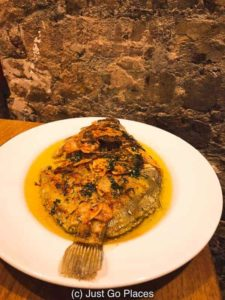 The Sabor Restaurant menu had a fish special of the day with baked garlic