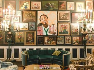 The Living Room at Jack Rose New Orleans with the Lil Wayne portrait.