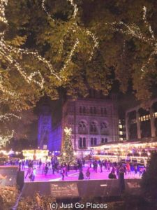 One of the big London family attractions in December is the ice skating rink outside the Natural History Museum.