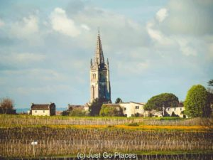 The spire of the St Emilion monolithic church can be seen from the fields of the Vineyards in St Emilion nearby.