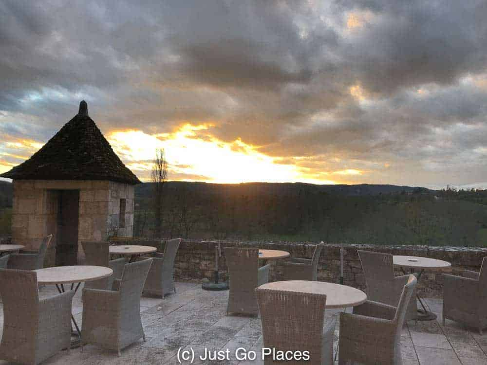 The view from the terrace of the sun setting over Lacave France.