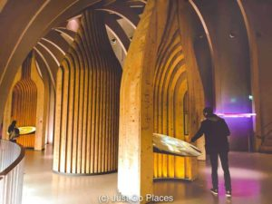 Interactive exhibits in artfully shaped wine bottle stands at the wine museum Bordeaux France