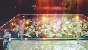Light and wine glasses create a modern art piece at the museum of wine Bordeaux