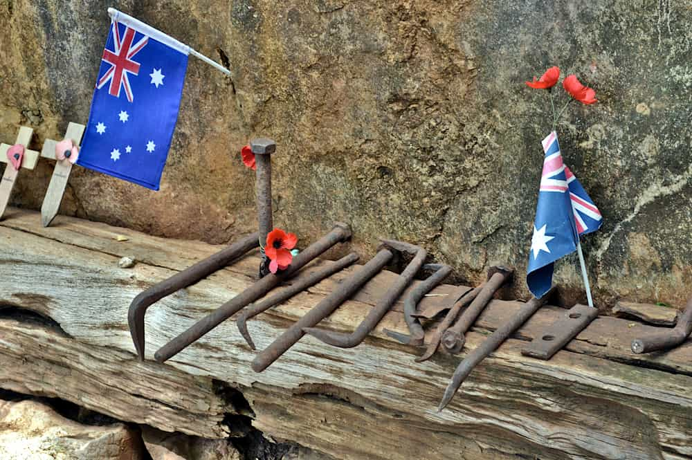 Tools and flags commemorate the prisoners of war who worked at Kanchanaburi and the Hellfire Pass Museum