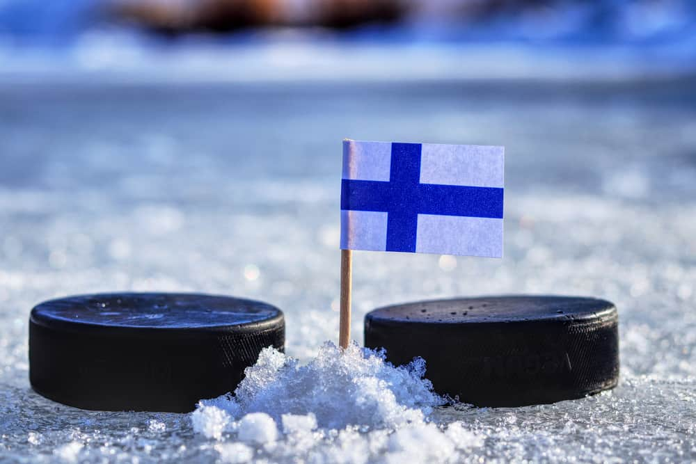 Finland Flag on a toothpick between two hockey pucks