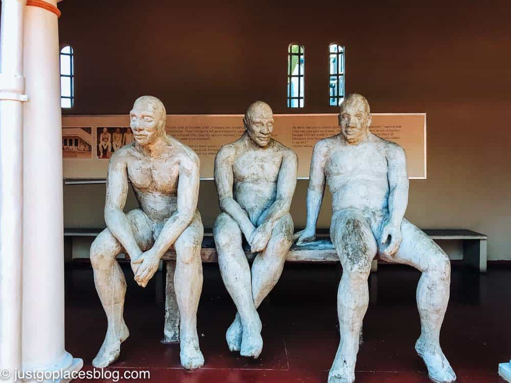 A statue at Kwa Muhle Museum of people waiting to get their passes to work in Durban