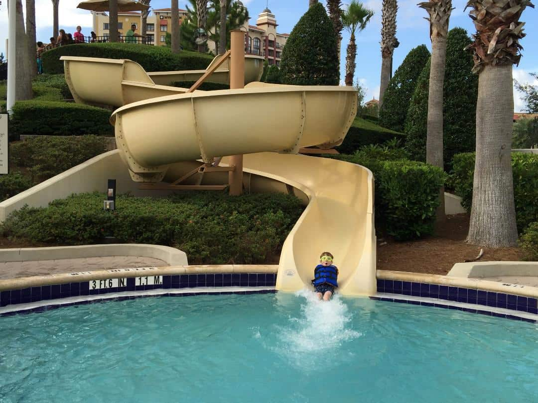 child on waterside at the Hilton Orlando Bonnet Creek pool
