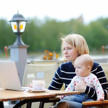 mother with baby working on computer