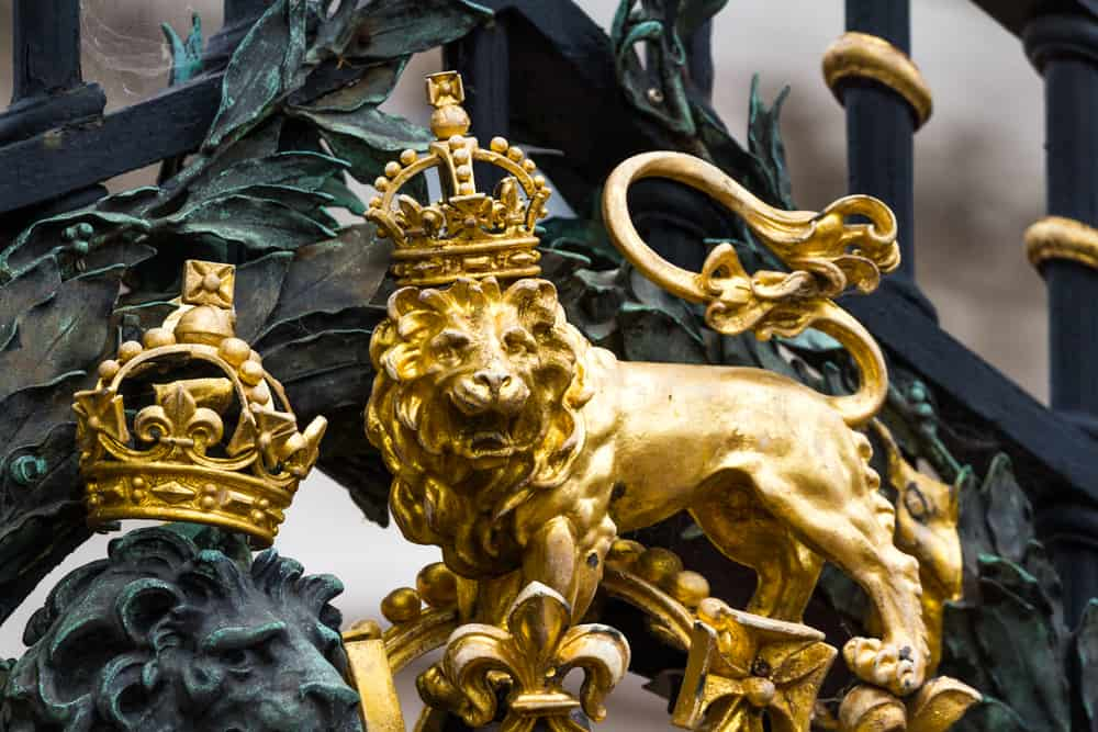 closeup of the golden lion on the Royal Coat of Arms on the front gates of Buckingham Palace in London