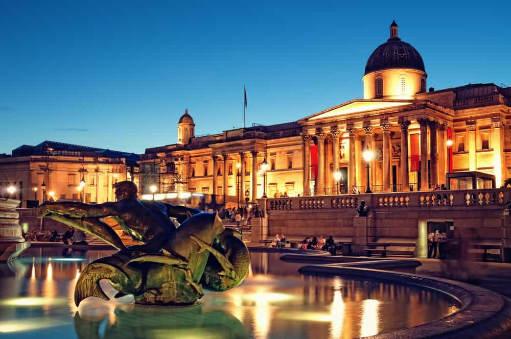 The National Gallery and Trafalgar Square at night.