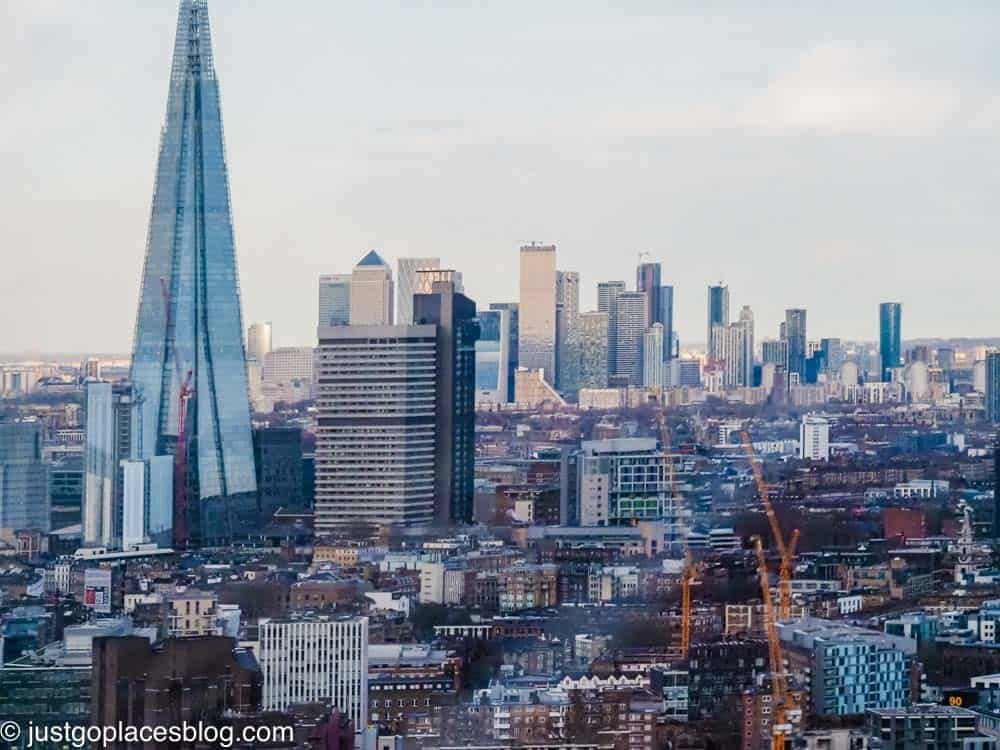 a view of the Shard and Canary Wharf