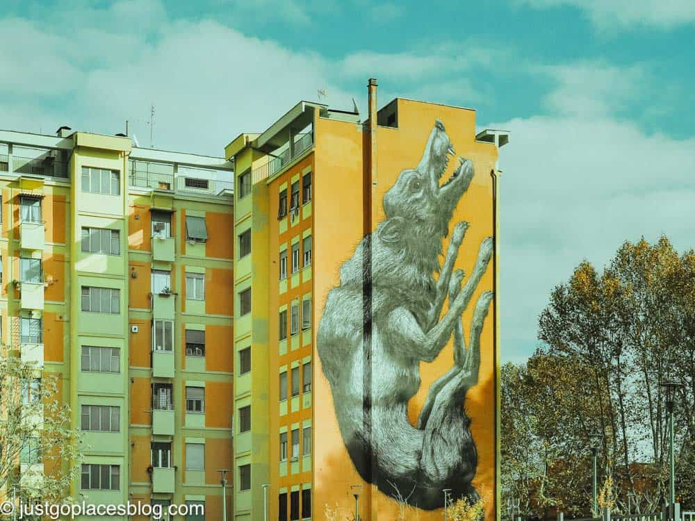 street art of the Roman wolf on the side of an apartment block