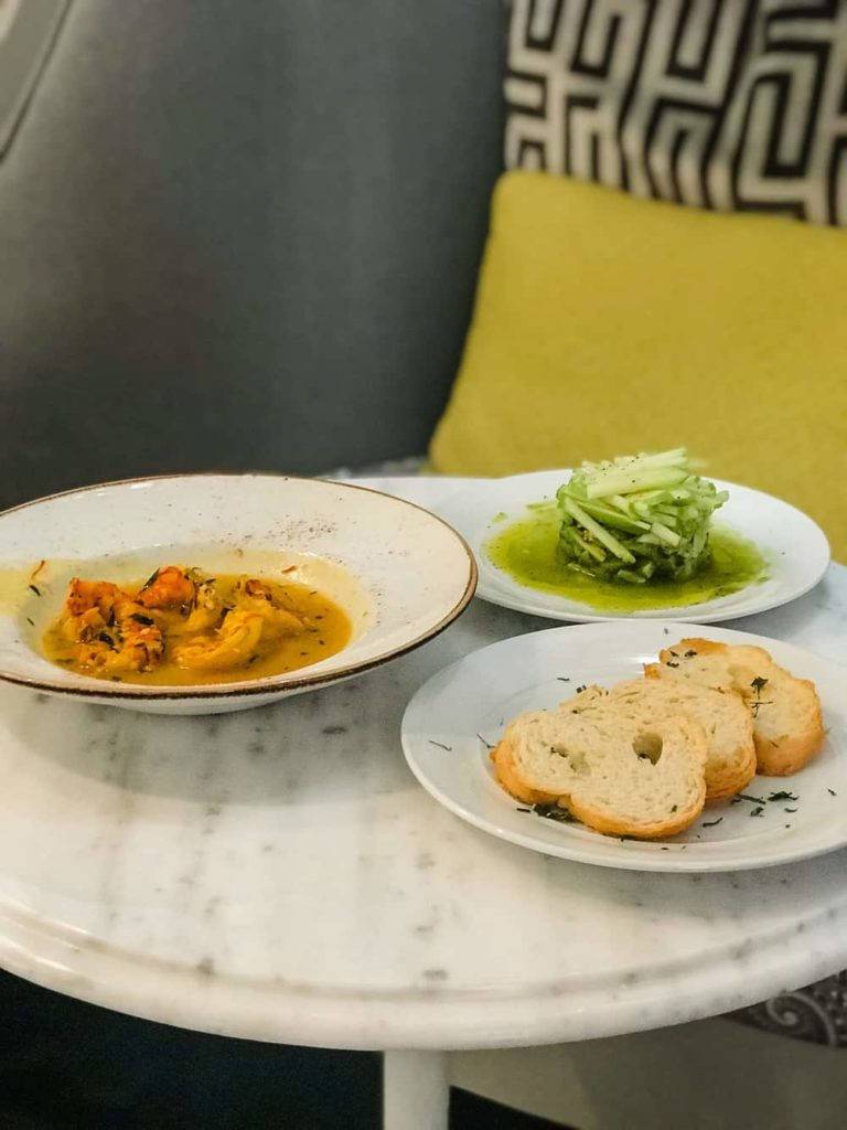 shrimp in sauce, bread and west indies salad at Elyton Hotel Room service
