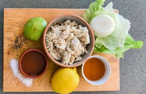 ingredients for West Indies Salad includes salt,peper, vinegar, oil, lemon, crabmeat, onion apple and lettuce