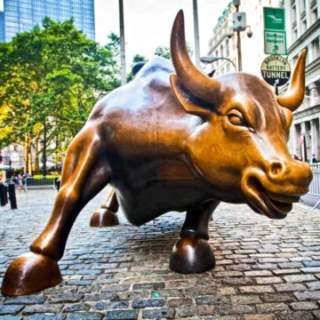The landmark Charging Bull in Lower Manhattan represents aggressive financial optimism and prosperity