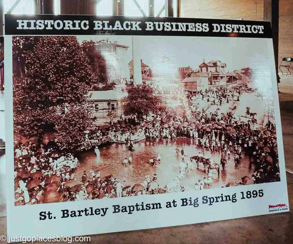A sign of a giant baptism in Big Spring Park in the 19th century.