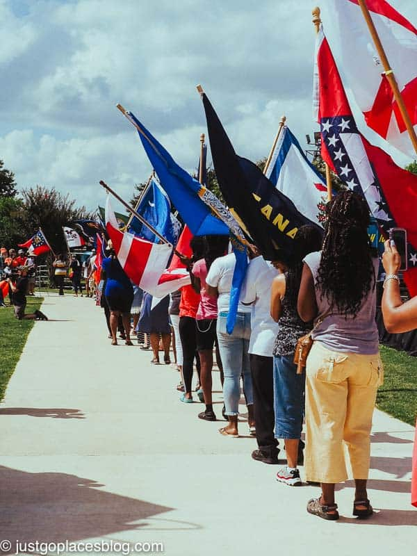flags being waved by marchers in a Juneteenth parade