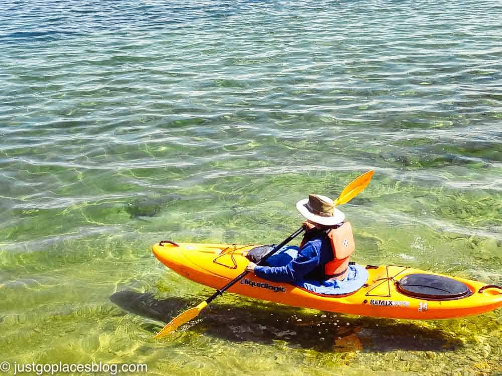 Person in a kayak at Yellowstone Lake