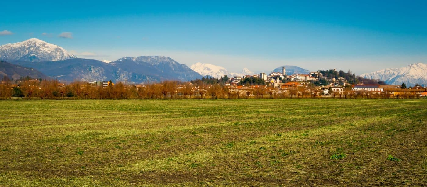 panorama of San Daniele del Friuli showing the mountains and the fields