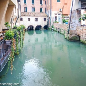 Things to do in Treviso include sitting in a Treviso restaurant on a canal