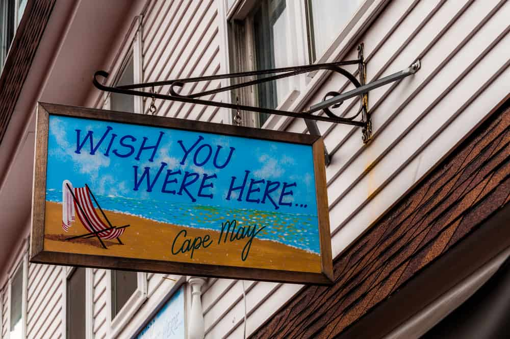 """Colorful """"Wish You Were Here"""" postcard sign in Cape May, New Jersey."""