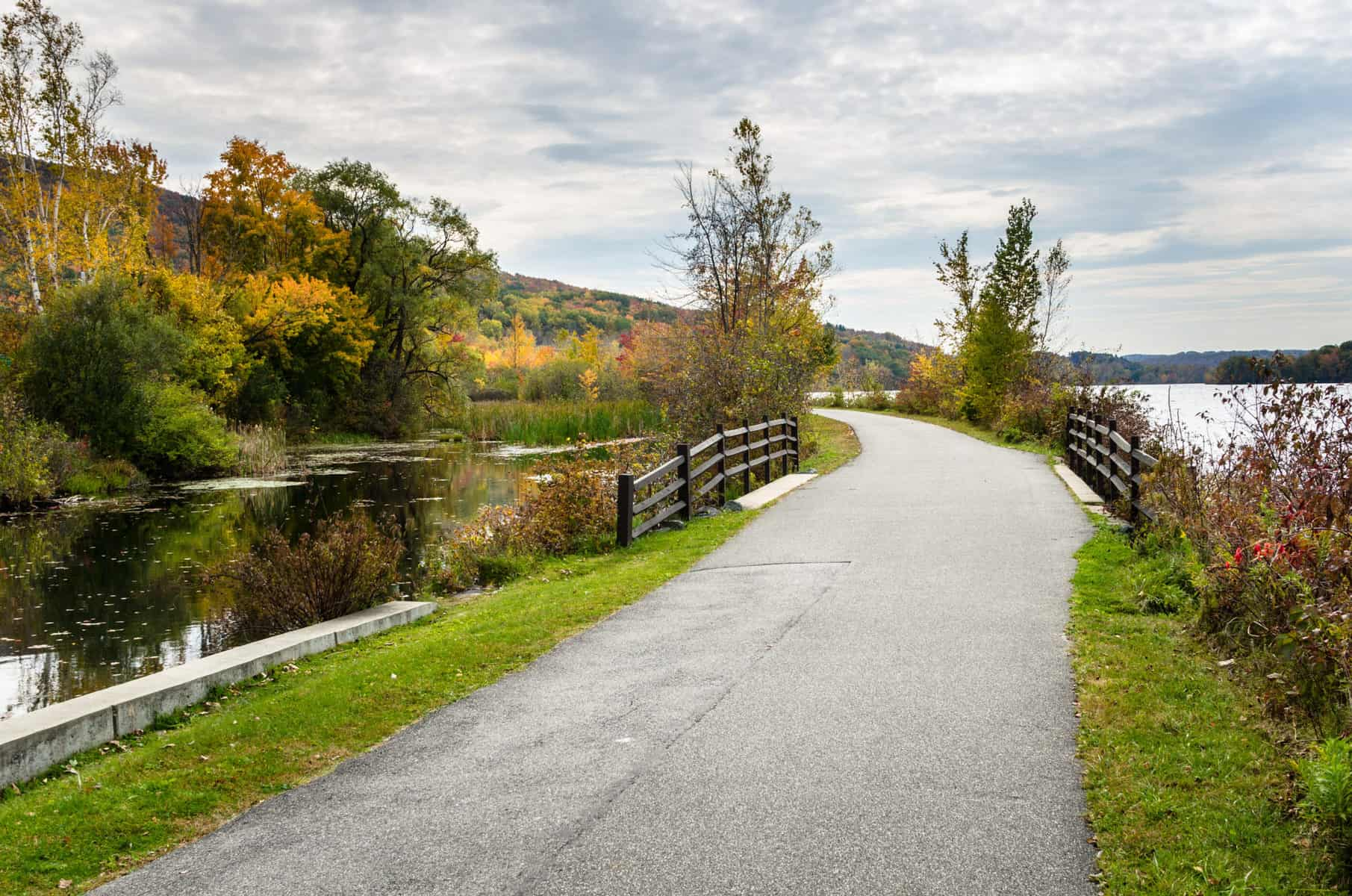 Winding Laakeside Path for Pedestrian and Cyclists on a Cloudy Autumn Day. The Berkshires, MA