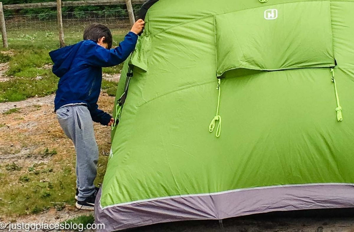 setting up the tent for camping