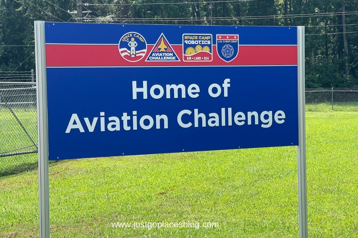 """a banner reading """"home of Aviation Challenge"""""""