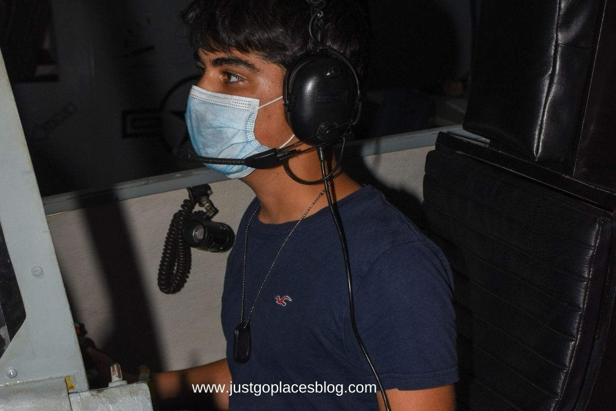 boy in a aircraft simulator in Aviation Challenge