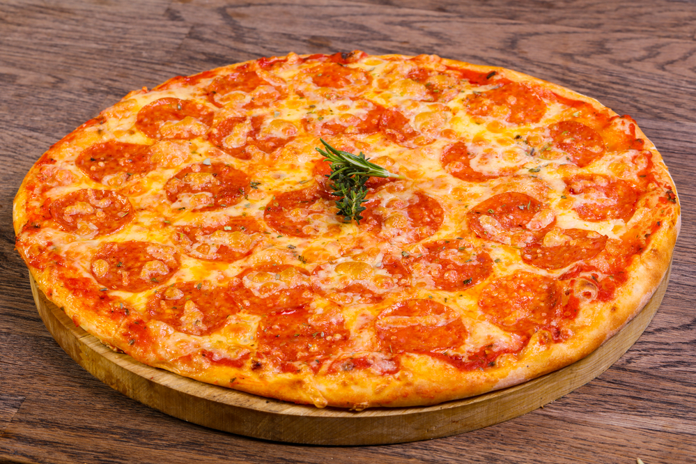Hot Pepperoni pizza with cheese and tomato